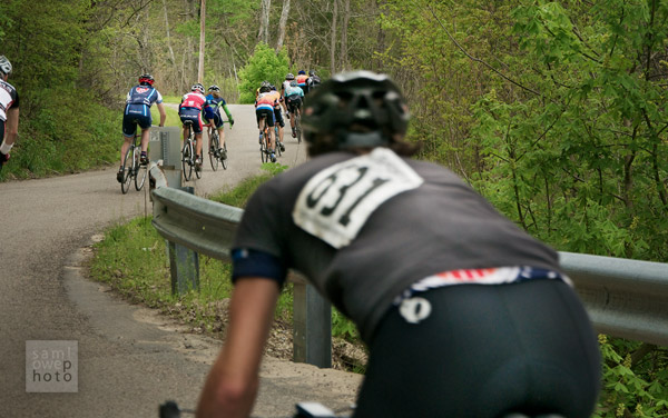 A cyclist struggles to keep up with the group
