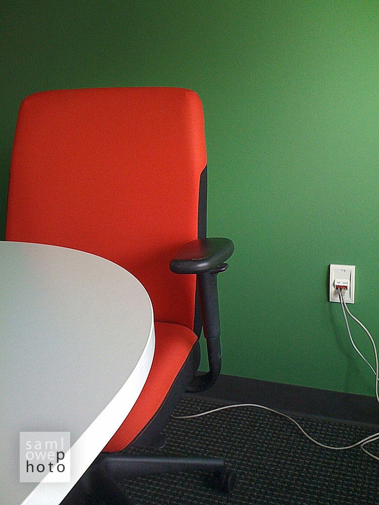 red office chair. green office wall.